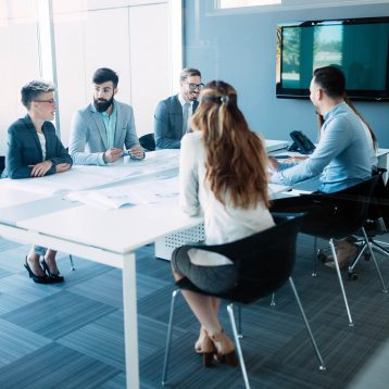 business-colleagues-in-conference-room-TVHD5EM.jpg